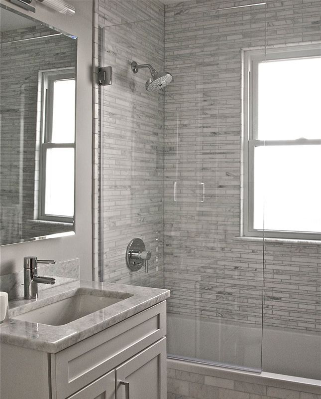 frameless tub shower glass screen idea for master bath tub