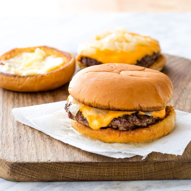 Wisconsin Butter Burgers are a Midwestern favorite. We let our burgers form crispy edges on the stove before plopping them on a buttered buns with a heap of buttery onions.