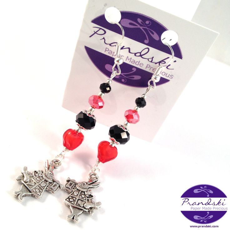 Silver plated dangle earrings. Alternating red and black faceted beads and red heart drop to an Alice in Wonderland White Rabbit charm.     • Two Tibetan silver Alice in Wonderland White Rabb...