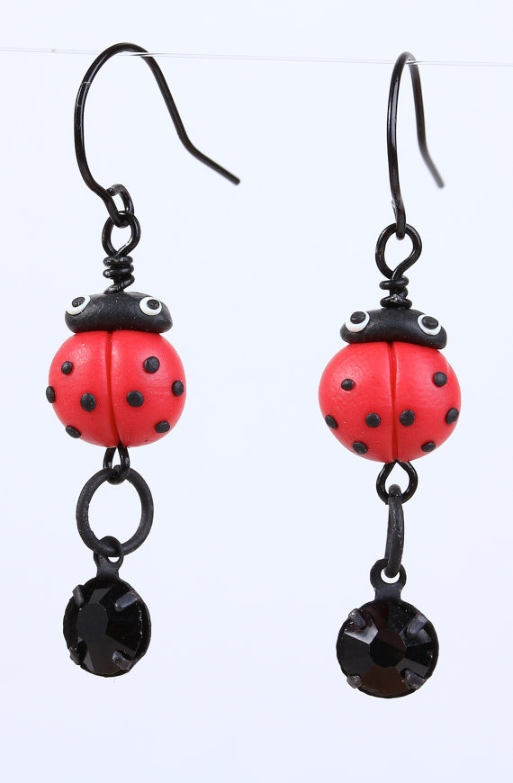 Tiny ladybugs made out of polymer clay spice up dangling black crystals at the end of the earrings. You will truly enjoy the details on the ladybugs. Handcrafted in USA.   Length: 1 6/8.