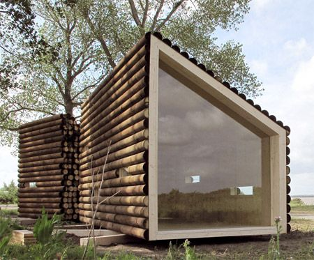 Flake house by Olgga Architects is a modern take on the classic log cabin