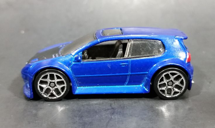 2007 Hot Wheels VW Volkwagen Golf GTI Metalflake Blue Die Cast Toy Car Vehicle https://treasurevalleyantiques.com/products/2007-hot-wheels-vw-volkwagen-golf-gti-metalflake-blue-die-cast-toy-car-vehicle #2000s #HotWheels #VW #Volkwagen #Golf #GTI #Metalflake #Blue #Diecast #Toys #Cars #Vehicles #Collectibles #Hatchbacks #Autos #Automobiles #MustHaves #BuyNow