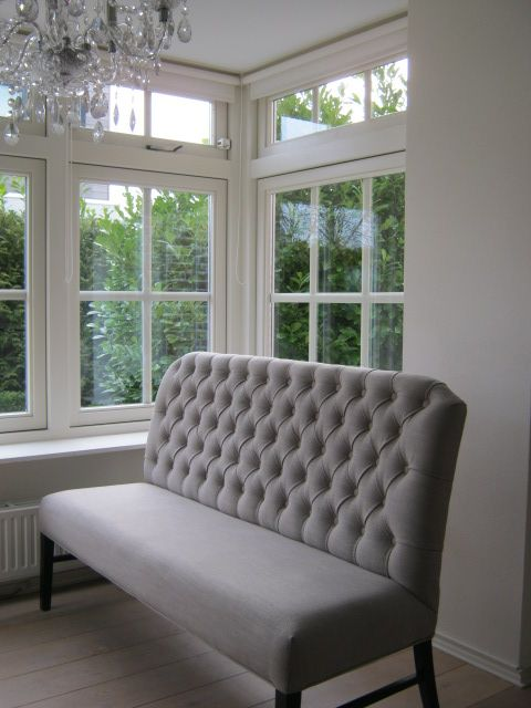 """beautiful tufted gray banquette seating - I realize the """"tufted"""" look is not really your style but the idea of having a bench seat will give you more options"""