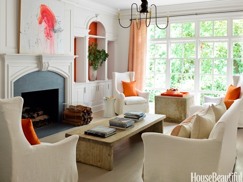 Pops of orange: Orange, Houses Beautiful, Living Rooms, Wings Chairs, Color, Fireplaces, Interiors Design, Coff Tables, Natural Wood