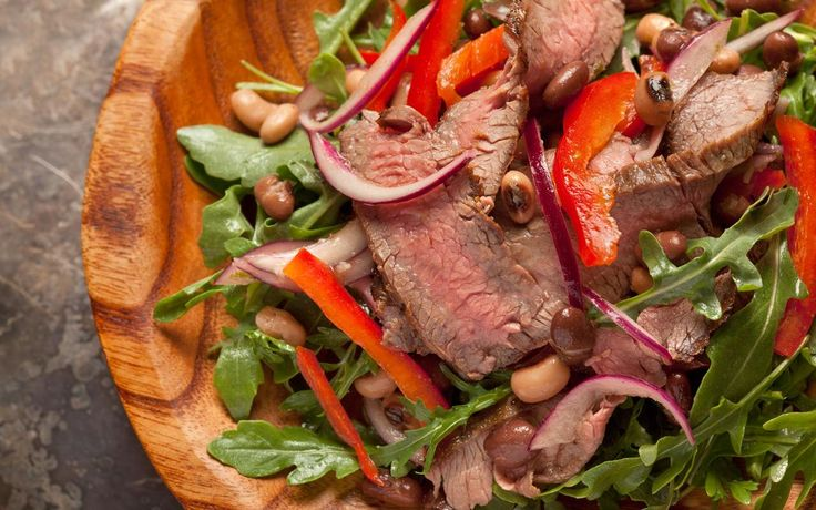 Flank steak and arugula salad.  Hearty yet healthy, this steak salad has black beans, black-eyed peas, red onions, and sweet bell peppers.