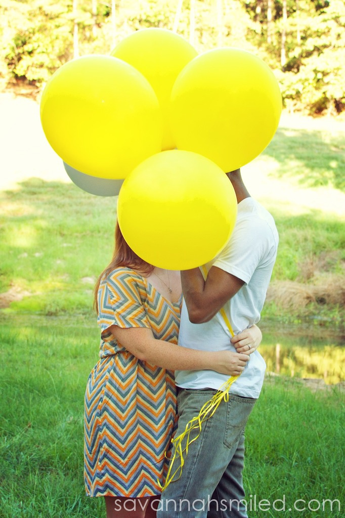 A pile of balloons: Engagement Pictures