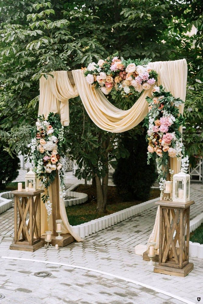 wedding ceremony decorations with peach cloth draping and roses anishenkowithlove