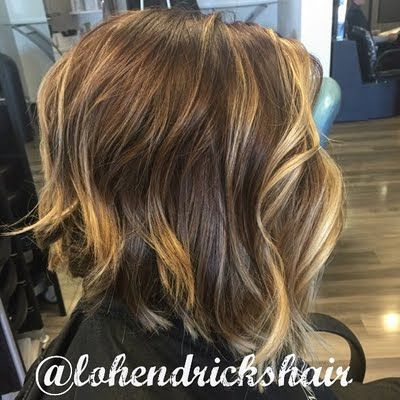 Sassy meets sexy defines this wavy angle cut brunette bob with gorgeous blonde highlights. Be inspired to learn the art of Balayage and DIY this do using the listed products.