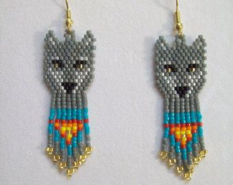 These Beautiful Native American Beaded Earrings are custom made by Elaine out of Turquoise, Black, Silver and Teal with Black bugle beads on them. They are 4 in. long with Silver ear wires on them, can be changed to post or clips. If you like them and want in other color just let me know I do speical orders. Thanks for looking.