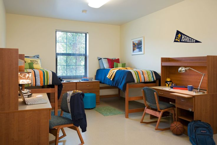 Webster University East and West Residence Halls The room looks so neat and everything. Haha. I can almost guarantee that my room will not look this neat and matchy.