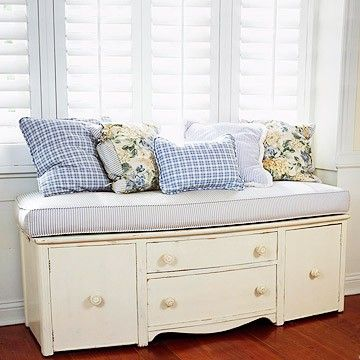 Cut the legs off of an old dresser, and add a cushion. awesome!