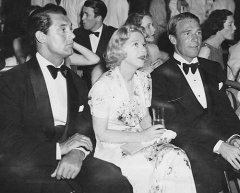 Glenda Farrell between Cary Grant and Randolph Scott.
