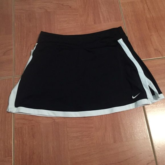 Black and white Nike skirt! Adult small Black and white Nike skirt! Adult small!! Perfect for Tennis, running, or cheerleading!! Worn once for cheer tryouts Nike Skirts