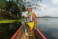 Embera Indian woman in a dugout canoe on the Chagres River, Soberania National Park (near Panama Canal), Panama | Blaine Harrington III