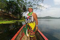 Embera Indian woman in a dugout canoe on the Chagres River, Soberania National Park (near Panama Canal), Panama | Blaine Harrington III