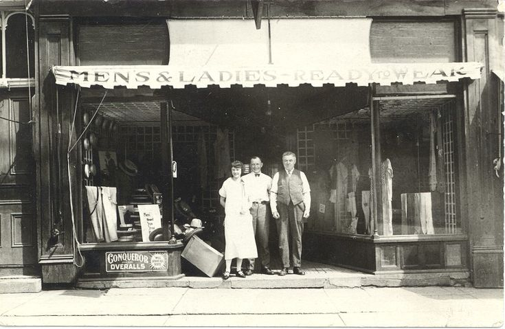 This photo, taken around 1925, shows the McMillan Clothing Co. which opened as early as 1915 at 195 Broadway.