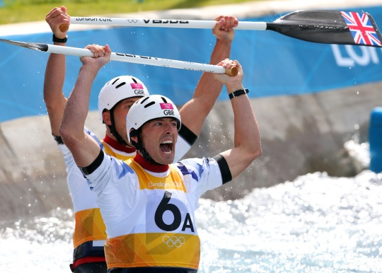 David Florence (right) of Great Britain and his team mate Richard Hounslow react after competing in the Mens`s Canoe Double (C2) finale on Day 6 of the London 2012 Olympic Games at Lee Valley White Water Centre on August 2, 2012 in London, England. Florence and Hounslow won the silver in the event, as fellow Brits Tim Baillie and Etienne Stott took the gold.    Credit: Alexander Hassenstein/Getty Images
