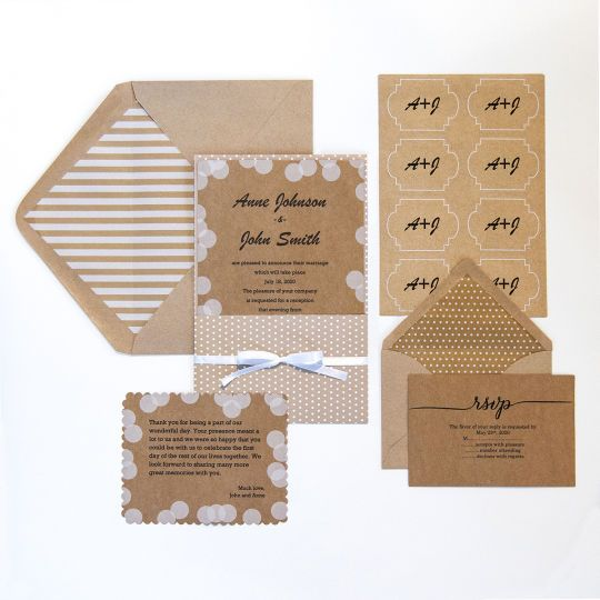 <div>This invitation suite uses dot and stripe patterns on card stock that looks like kraft pape...