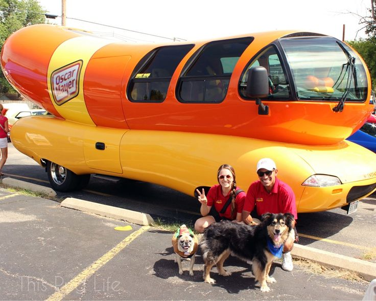 Pug and Molly visit the Oscar Mayer Wiener Mobile.  I still have a wiener whistle that little Oscar game me when I was about 9 years old!