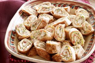 Baked Mexican Pinwheels. These are always a hit at parties when I make them! Substitute the cilantro for jalapenos!