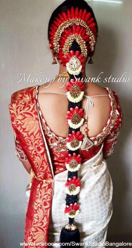 Traditional Southern Indian bride's bridal braid hair. Hairstyle by Swank Studio. Silk Saree. Sari Blouse Design. Hair Accessories. Silk Kanjeevaram sari. Braid with fresh flowers. Tamil bride. Telugu bride. Kannada bride. Hindu bride. Malayalee bride. Find us at https://www.facebook.com/SwankStudioBangalore