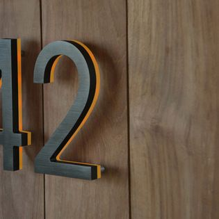 """Illuminated Bronze House Numbers 8"""" - Outdoor Backlit Signs - The Bronze 8"""" inch LED Illuminated House Numbers. The numbers are finished is ..."""