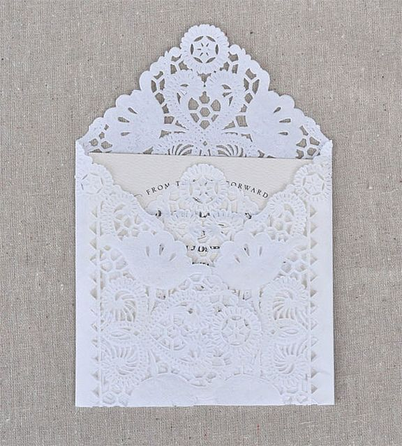 "So elegant. Like a lace evening gown of an envelope.    I think the best way to do this is to fold a 12"" doily first, to see what size card will fit- then print and cut the cards to suit the size of the lace envelope..      Image Via: This is Glamorous"
