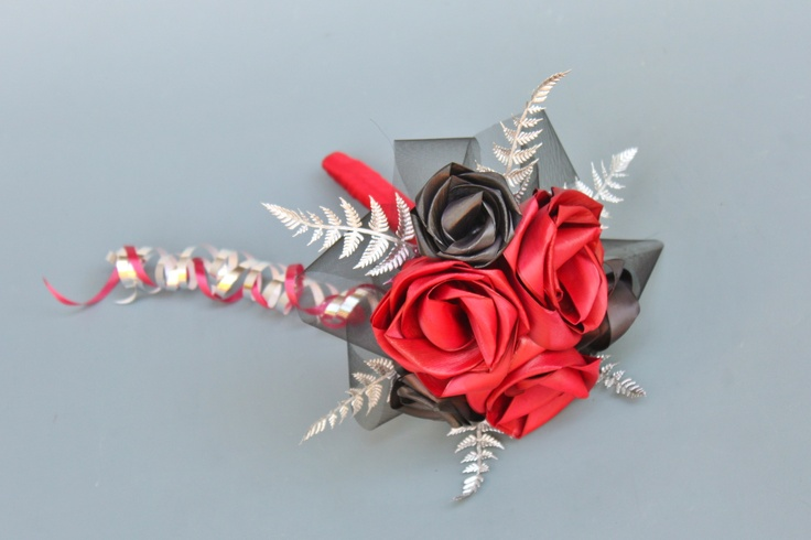 Six flower flowergirl posy in Red & Black with silver fern and cascading loops.  www.flaxation.co.nz