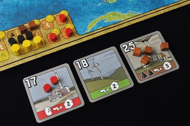 Power Grid board game to teach kids about money on top of Monopoly and Pay Day