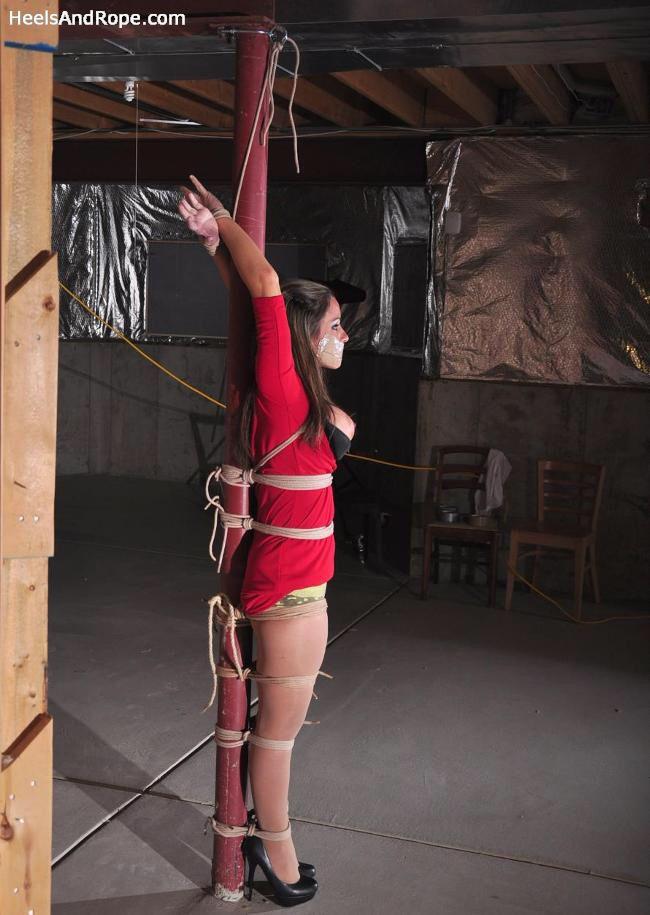 bondage woman to pole