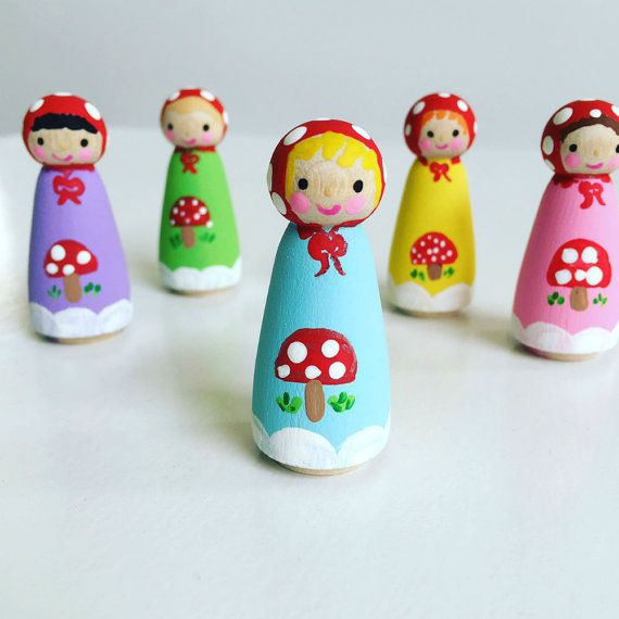 This set of Woodland Peg Dolls is so colorful and whimsical! Children love the little red bonnets with the polka dots- and the toadstools! So