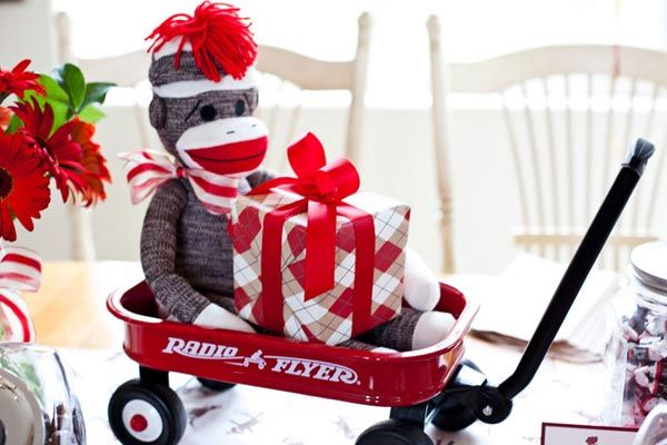 Sock Monkey themed baby shower -- red & brown -- would also be cute for a little boy's birthday.