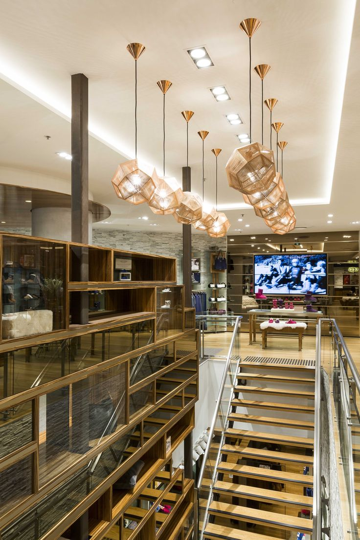 Timber Stairway with feature pendant lights. UGG store Sydney