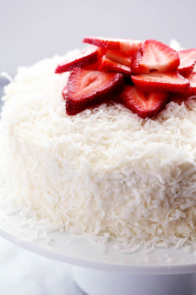 A delicious and moist strawberry coconut cream cake with an amazing coconut cream cheese frosting! I love the flavor combination of strawberry and coconut.  I recently had a strawberry coconut milkshake that was AMAZING.  So as soon as Pillsbury sent me this Strawberry Cake Mix, I knew that I wanted to make a Strawberry Coconut …