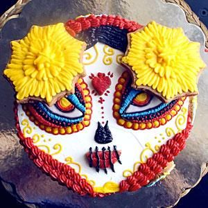 This cake, inspired by the character La Muerte from Book of Life, is—in a word—flawless. Watch JK Denim assemble the pieces while your jaw slowly drops to the floor. Download your own La Muerte stencils here.