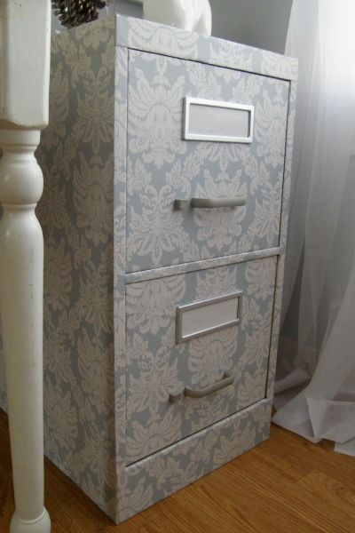 This lovely filing cabinet adds some subtle style. Done with wallpaper and modge podge.