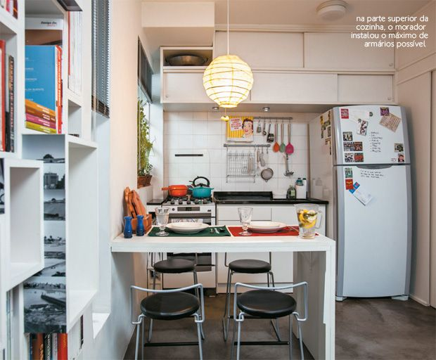 Small kitchen in a studio apartment tiny apartment for Tiny apartment kitchen solutions