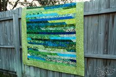 """Standard Jelly Roll race. Also sometimes seen with 2 1/2"""" sq of contrast at strip joins. Finished – Bali Pop Jelly Roll Race quilt 