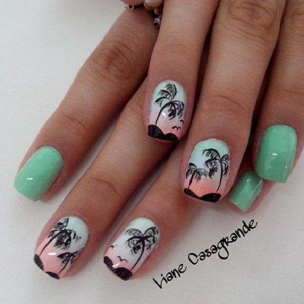 A pretty Palm Tree Nail Art design. The palm trees are in silhouette as the sky looks very welcoming sunrise beneath them. The light pastel greens also help set the mood.