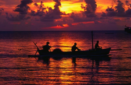 Fishermen silhouetted against sunset - Lovina Beach, Bali