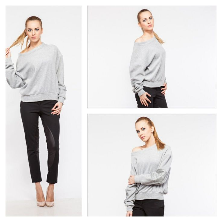 Cozy grey fleece sweater pith sequence arm patches and black riding pants paired with nude stilettos.