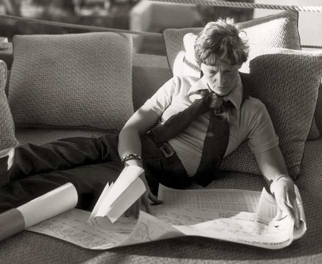 In January 1935, Amelia Earhart studies maps and charts at the Royal Hawaiian Hotel in Honolulu.
