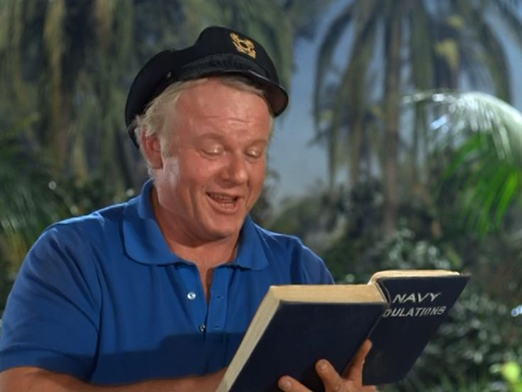 "Alan Hale, Jr., as ""Skipper"" in ""Gilligan's Island"" reading ""Navy Regulations"" -- a bit too late!"