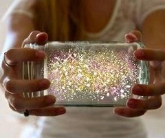 How To Make Fairies In A Jar   1. Cut a glow stick and shake the contents into a jar. Add diamond glitter    2. Seal the top wi
