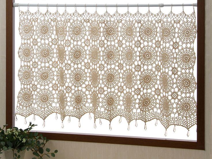 This is so cool. A crochet curtain. I love this. I know how to crochet..
