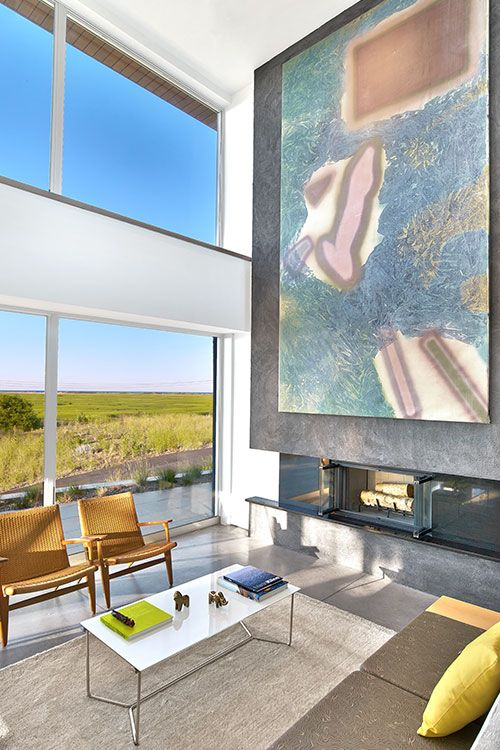 Amazing living room design idea in a contemporary beach house with stunning views by Hariri Hariri Architecture