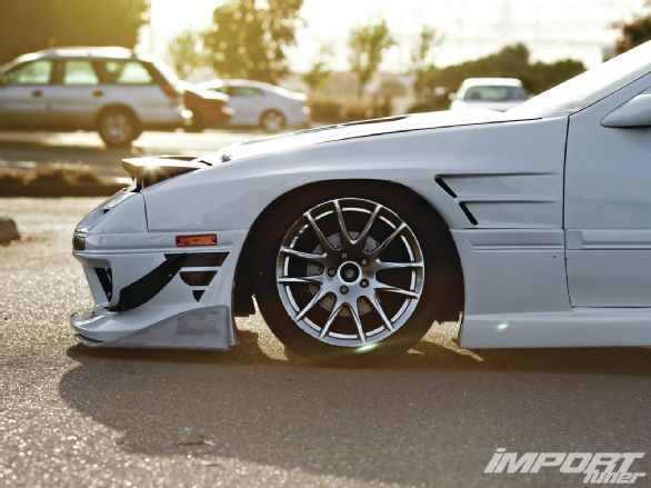 Check out Lexis King's Z06-hunting 1988 Mazda RX-7 Turbo with its AIT G4 body kit, street ported 13BT engine, Garrett GT3582R turbo, custom v-mount intercooler, and more! - Import Tuner Magazine