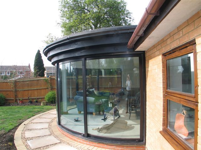 curved doors in a conservatory walton on thames in surrey