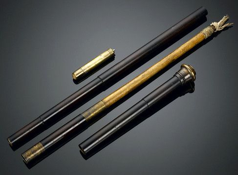 "A walking stick of exceptional rarity, this torch cane contains handy tools for use in case of an emergency. Tucked within the metal shaft is a 19-inch torch with a wooden shaft to light one's way in the darkness. The brass ferrule also doubles as a holder for extra fuel, ensuring a long-lasting flame. Topped by a brass handle that also serves as a whistle, this is the perfect piece to guide one to safety.  35"" length"