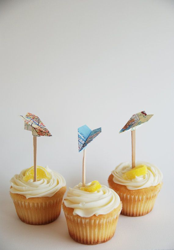 Birthday Party Ideas! Inspiration: map paper airplane cupcake toppers.